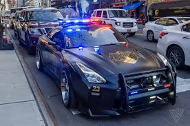 nissan gtr matte black and red this nissan gt r looks like the evil cop car from transformers