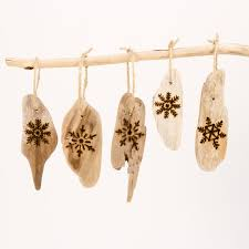 driftwood ornaments with wood burned snowflake