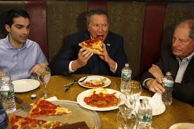 a brief history of politicians pizza with a knife and fork