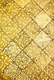 golden orange color close up golden color oriental antique style tiles wall texture