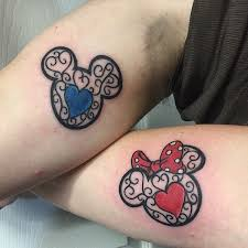 couple tattoo mickey mouse colorful mickey and minnie mouse faces matching couple disney