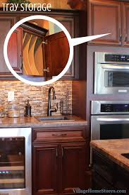 tall wall oven cabinets can be a great place to add storage for