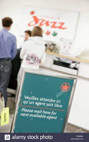 check in desk sign quebec city canada jean lesage international airport sign french
