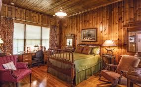 log home interior walls rustic log cabin bedroom pine wood walls neutral interior green