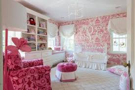 baby room with pink nursery wallpaper and white crib