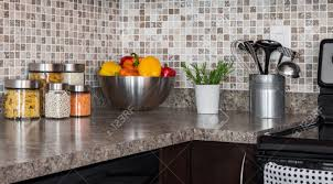 food ingredients and green herbs on modern kitchen countertop