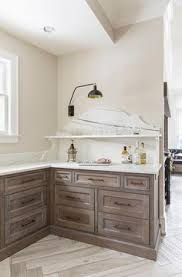cerused oak kitchen cabinets gray brushed oak cabinets with brass pulls the crib pinterest