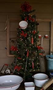 christmas tree decorated with antique red handled kitchen utensils