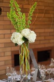 curly willow centerpieces centerpiece of white hydrangea bells of ireland and curly willow