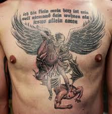 angry angel warrior beat evil and writing tattoo on men u0027s chest
