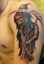 black and grey grim reaper on left half sleeve