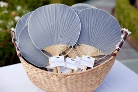 paper fans for wedding things to offer to your guests fancy fans wedding planning