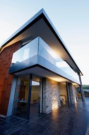 Glass Front House Sliding Minimal Windows And Fixed Structural Elements Provide A