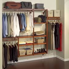 floating brown wooden closet racks with clothes hooks on light