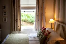 free image of small bedroom with a garden view