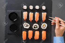 cuisine r up top view of sushi roll with chopsticks at restaurant