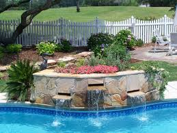 swimming pool with picket fences and waterfalls swimming pool
