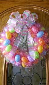 how to make an easter egg wreath easter wreath tutorial using plastic eggs and easter grass