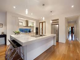 sleek kitchen design idea with high ceiling also brown cabinetry