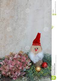 natural homemade christmas decoration with hydrangea and santa