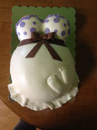 a baby belly cake with foot prints pink champagne baby shower