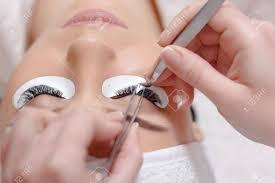 professional permanent makeup permanent makeup eyelash extension procedure woman eye with