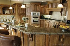 Rustic Kitchen Ideas - traditional medium wood brown kitchen cabinets for the home
