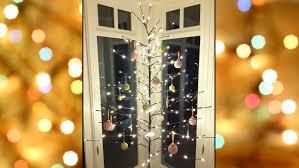 stick christmas tree with lights 15 alternative christmas trees babbletop