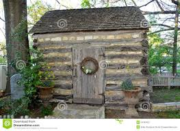 small wooden shed or cabin in the country stock photo image