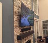 Tv Mount Over Fireplace by Curved Flat Screen Tv Mounted Over Fireplace Sound Bar Floating