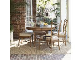 tommy bahama home beach house round coconut grove dining table shown with sanibel side chairs