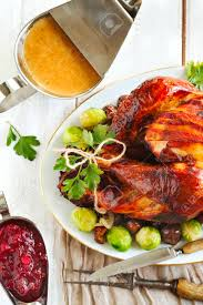roasted turkey with bacon and garnished with chestnuts and brussels