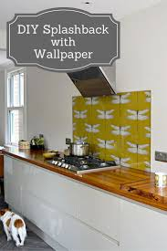wallpaper backsplash kitchen diy splashback using wallpaper pillar box blue