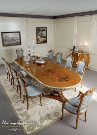 dining room with one piece carved and inlaid table dining room