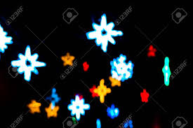 black colored christmas lights colorful beautiful multi colored christmas blur stars lights stock