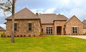 elegant acadian house plan with courtyard garage 510003wdy