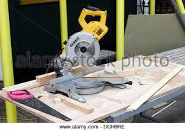 Bench Mounted Circular Saw Carpenter Cutting Wood With Circular Bench Saw Stock Photo