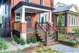 classic american style wooden front porch railing in a beautiful