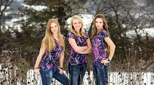 lifestyle camo female hunters stand together with pink camo