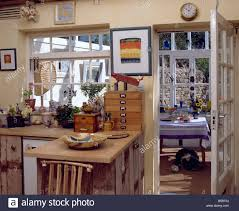 Kitchen Conservatory Designs Rustic Wooden Units And Worktop In Cottage Kitchen With Glazed