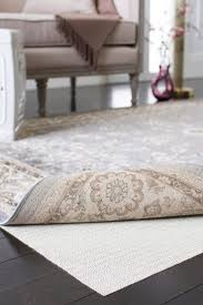 Rug In Living Room 4 Top Reasons Why You Need A Rug Pad Overstock Com