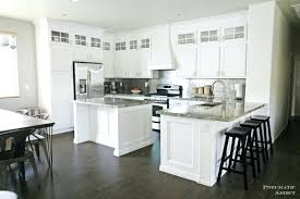 white cabinets black countertops and that faucetupper kitchen