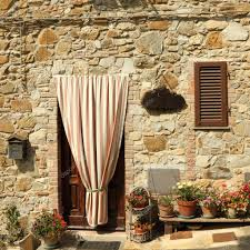 doorway to the tuscan house with striped outdoor curtain italy