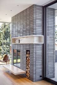 best 25 modern stone fireplace ideas on pinterest modern brick fireplace surround from a house in portland designed by hennebery eddy architects photography wood burning fireplacesindoor fireplacesstone