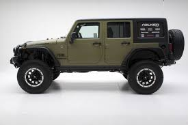 green jeep wrangler unlimited the mean green jeep unlimited rubicon w atx wheels and off road tires