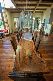 dining area with large wood table two small tables and three