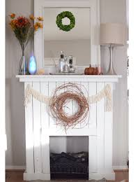 cheap easy faux fireplace with pallet wood perfect for the