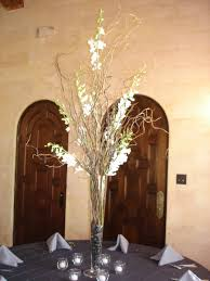 decorating beautiful white orchid and manzanita branches michaels
