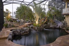lagoon pool remodel to tropical resort with slide grotto and