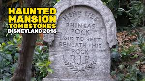 halloween headstones imagineer tombstones reinstalled at haunted mansion during 2016